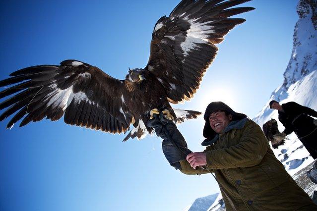 """Kazakh Eagle Hunters"". Eagle Hunting is a Kazakh tradition that dates back 2000 years. Around 350 Kazakh Eagle Hunters are keeping the tradition alive in the Altai Mountains, Mongolia. (Photo and caption by Tariq Sawyer/National Geographic Traveler Photo Contest)"