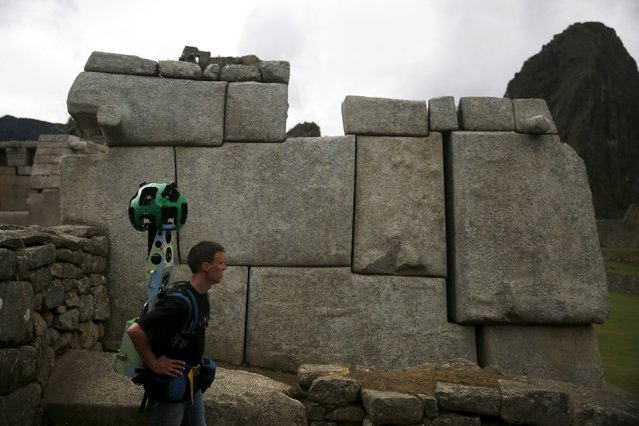 Daniel Filip, Tech Lead Manager for Google Maps, rests as he carries the Trekker, a 15-camera device, while mapping the Inca citadel of Machu Picchu for Google Street View in Cuzco, Peru, August 12, 2015. (Photo by Pilar Olivares/Reuters)