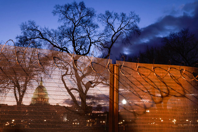 Razor wire and fences still surround the United States Capitol building at sunrise on January 23, 2021 a few days after the inauguration of President Joe Biden and Vice President Kamala Harris. The Capitol was breached during an insurrection January 6 just days before the inauguration. (Photo by Jeremy Hogan/SOPA Images/Rex Features/Shutterstock)