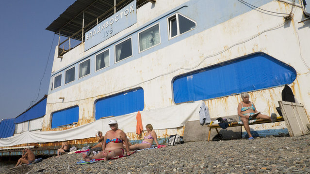 """Russians sun bathing in Vladivostok"". Surpising! 22°C in Vladivostok in October. People enjoy themselves on Russian beaches across from Japan. (Photo and caption by Eve Van Soens/National Geographic Traveler Photo Contest)"