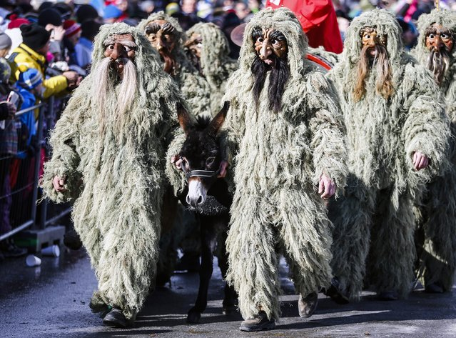 Men in costumes and traditional masks take part in the Schleicherlaufen festival in the western Austrian town of Telfs February 1, 2015. (Photo by Dominic Ebenbichler/Reuters)