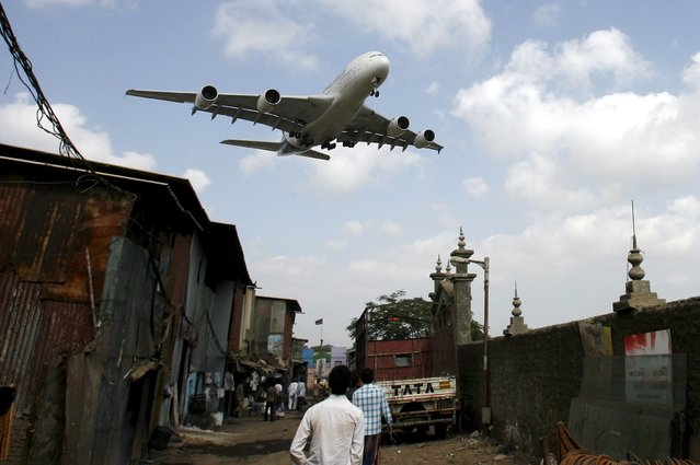 An Airbus A380 aircraft prepares to land at Mumbai airport in this May 8, 2007 file photo. Sentiment at some of Asia's biggest firms deteriorated again in the fourth quarter, falling to a four-year low under the weight of concerns about slowing growth in China, the region's biggest economy, a Thomson Reuters/INSEAD survey showed. (Photo by Arko Datta/Reuters)