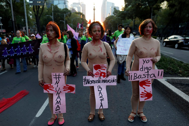 "Women hold placards during a demonstration to commemorate the U.N. International Day for the Elimination of Violence against Women in Mexico City, Mexico, November 25, 2016. The crosses read (L-R) ""Not one more"", ""No More Femicide, enough"", ""I say enough"". (Photo by Carlos Jasso/Reuters)"