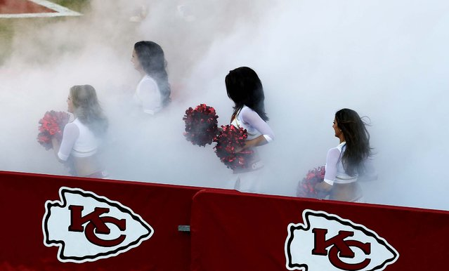 Kansas City Chiefs cheerleaders prepare to perform during a preseason game against the San Francisco 49ers  at Arrowhead Stadium in Kansas City. (Photo by Orlin Wagner/Associated Press)