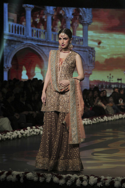 A model presents a creation of designer Umsha by Uzama Babar during Bridal Couture Week 2016 in Lahore, Pakistan, Sunday, November 27, 2016. (Photo by K.M. Chaudary/AP Photo)