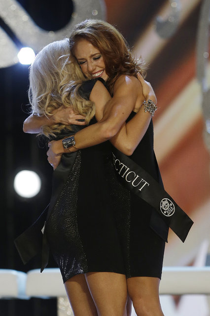 Miss Connecticut Kaitlyn Tarpey, right, hugs Miss Georgia Carly Mathis during the Miss America 2014 pageant, Sunday, September 15, 2013, in Atlantic City, N.J. (Photo by Mel Evans/AP Photo)