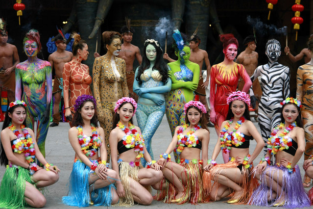 Chinese models with animal-themed body paintings pose during a campaign for animal protection at Sanya Color Zoo in Sanya city, south China's Hainan province, 10 January 2016. The girls wearing strapless bras and short pants only were colored with animal-themed paintings such as zebra, cheetah, tiger and peacock. They paraded throughout the newly-opened Sanya Color Zoo and met visitors to take pictures, causing envies from netizens living in north China who are suffering chills. (Photo by Imaginechina/Splash News)