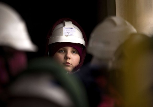 A child looks on upon returning with others after spending time at the facilities of Belarus' Republican Clinic of Speleotherapy within a salt mine, as part of their treatment, near the town of Soligorsk, south of Minsk, February 19, 2015. (Photo by Vasily Fedosenko/Reuters)