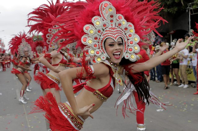 Members of a troupe dance during Battle of Flowers parade at carnival in Barranquilla, Colombia, 14 February 2015. (Photo by Ricardo Maldonado Rozo/EPA)