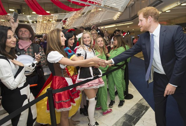 Britain's Prince Harry greets a well wisher as he takes part in a charity trading day at ICAP  in support of his charity Sentebale, in London, December 7, 2016. (Photo by Geoff Pugh/Reuters)