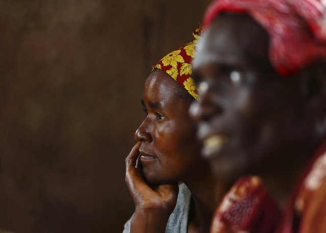 HIV-positive members of a self-help group meet with a caregiver in the village of Michelo, south of the Chikuni Mission in the south of Zambia February 23, 2015. (Photo by Darrin Zammit Lupi/Reuters)