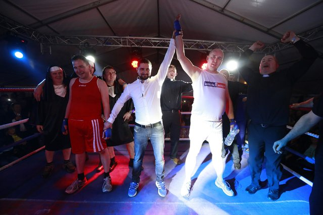 Fr Pierre Pepper (2nd R) reacts after defeating Jared Madden (2nd L) during his amateur boxing match in the town of Banagher  in County Offaly March 15 , 2015. (Photo by Cathal McNaughton/Reuters)