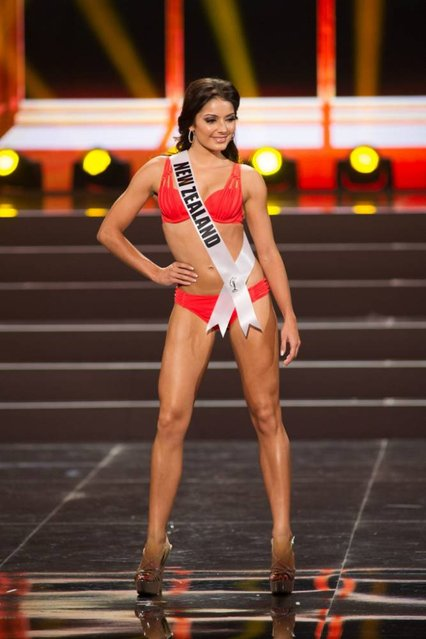 This photo provided by the Miss Universe Organization shows Holly Cassidy, Miss New Zealand 2013, competes in the swimsuit competition during the Preliminary Competition at Crocus City Hall, Moscow, on November 5, 2013. (Photo by Darren Decker/AFP Photo)