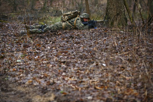 Robert Przybyl takes position during a territorial defence training organised by paramilitary group SJS Strzelec (Shooters Association) in the forest near Minsk Mazowiecki, eastern Poland March 14, 2014. (Photo by Kacper Pempel/Reuters)