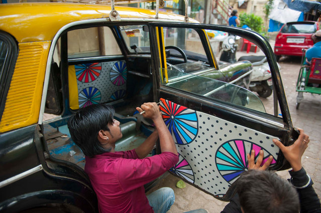 "The designers are encouraged to speak to the driver they are designing for, develop a relationship and work from there: ""One can't tell the story of the other if they don't know one-another"", they say. (Photo by Sandesh Parulkar/Taxi Fabric/The Guardian)"