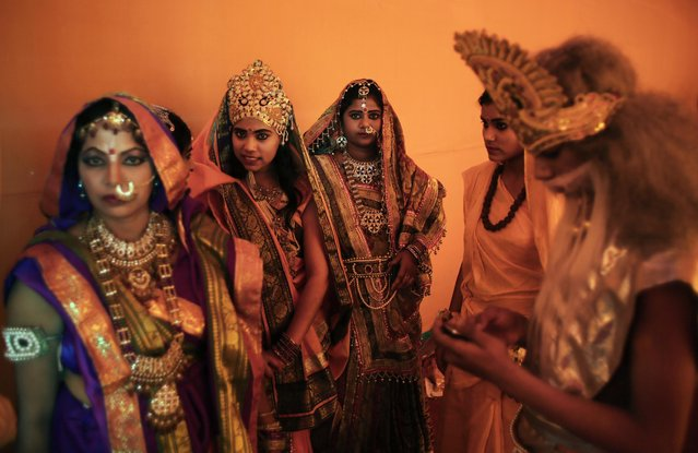 Hindus dressed in the likeness of mythological characters wait to participate in a religious procession on Ram Navami festival in New Delhi, India, Saturday, March 28, 2015. (Photo by Altaf Qadri/AP Photo)