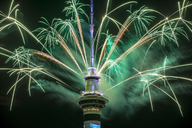 The SkyTower firework display during New Year's Eve celebrations on January 1, 2017 in Auckland, New Zealand. The pyrotechnic display includes 500kgs of fireworks, 1 tonne of equipment and 10 kilometres of wire were used in the display set up. (Photo by Dave Rowland/Getty Images)
