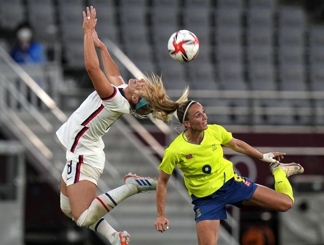 Midfielder Lindsey Horan (9) of Team United States and midfielder Kosovare Asllani (9) of Team Sweden go up for a header during the first round of the Tokyo 2020 Olympic Games at Tokyo Stadium on Wednesday, July 21. 2021. Sweden defeated the United States of America 3-0. (Photo by Toni L. Sandys/The Washington Post)