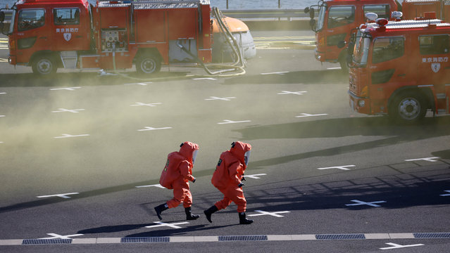 Members of Japan's chemical unit in protective gear perform drills during a New Year demonstration by the fire brigade in Tokyo, Japan, January 6, 2017. (Photo by Toru Hanai/Reuters)