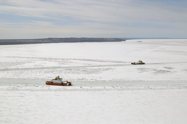 United States Coast Guard ships are shown in this aerial photo near Whitefish Bay on Lake Superior northwest of Sault Ste. Marie, Ontario April 7, 2015. The icebreakers are participating in an effort to free eight freighters from heavy ice in eastern Lake Superior as the biggest ice cover on the Great Lakes in decades is backing up shipments of everything from Canadian grain to U.S. (Photo by Kenneth Armstrong/Reuters)