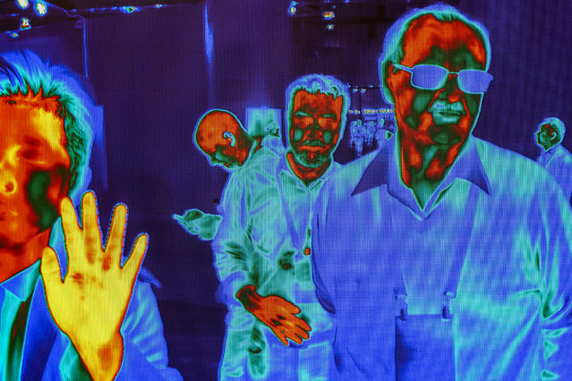 People are captured by FLIR (Forward-Looking Infrared) HD Thermal Imaging Cameras as they walk near the FLIR exhibit at the Las Vegas Convention Center during CES 2019 in Las Vegas on January 10, 2019. (Photo by David McNew/AFP Photo)