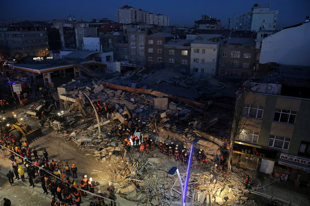 Firemen and rescue workers stand on the wreckage of a building that collapsed and caused several casualities, according to local media, in Istanbul, Turkey, January 13, 2017. (Photo by Huseyin Aldemir/Reuters)
