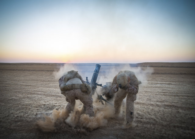 In this September 10, 2018, photo released by the U.S. Marines, Marines with Weapons Company, 3rd Battalion, 7th Marine Regiment, fire mortars from an undisclosed location in Syria. The United States' main ally in Syria on Thursday, Dec. 20, 2018, rejected President Donald Trump's claim that Islamic State militants have been defeated and warned that the withdrawal of American troops would lead to a resurgence of the extremist group. (Photo by U.S. Marine Corps photo by Cpl. Gabino Perez via AP Photo)