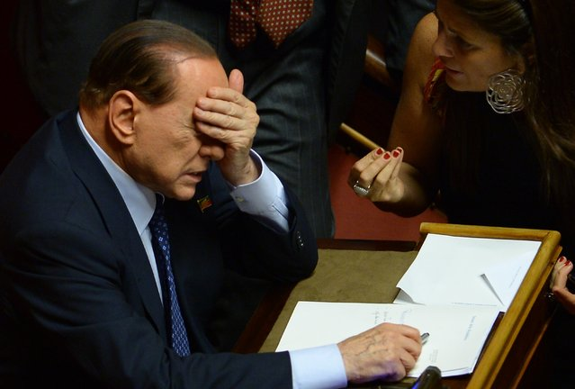 Former Prime Minister and leader of Forza Italia, Silvio Berlusconi gestures on October 2, 2013 at the Senate in Rome before today's Prime Minister Enrico Letta's confidence vote at the Parliament. (Photo by Filippo Monteforte/AFP Photo)