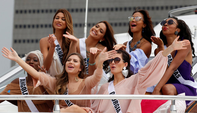 Miss Universe candidates pose for photographers while onboard a yacht before going to a beach resort in Manila, Philippines January 19, 2017. (Photo by Erik De Castro/Reuters)