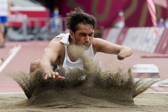 Afghanistan's Hossain Rasouli competes in the men's T47 long jump during the 2020 Paralympics at the National Stadium in Tokyo, Tuesday, August 31, 2021. (Photo by Eugene Hoshiko/AP Photo)