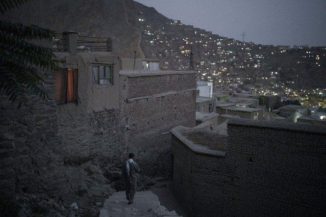 A man walks down the stairs at dusk in Kabul, Afghanistan, Saturday, September 11, 2021. (Photo by Felipe Dana/AP Photo)