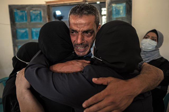 Relatives of Palestinian Omar al-Nile, 12, who was shot on Saturday during a violent demonstration on the eastern border between Gaza and Israel, mourn during his funeral on August 28, 2021 in Gaza City, Gaza. (Photo by Fatima Shbair/Getty Images)