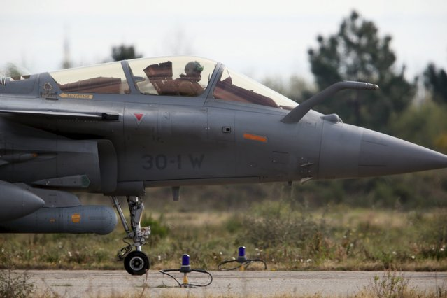 A pilot prepares to take off on a Rafale fighter jet during the close air support (CAS) exercise Serpentex 2016 hosted by France in the Mediterranean island of Corsica, at Solenzara air base, March 16, 2016. (Photo by Charles Platiau/Reuters)