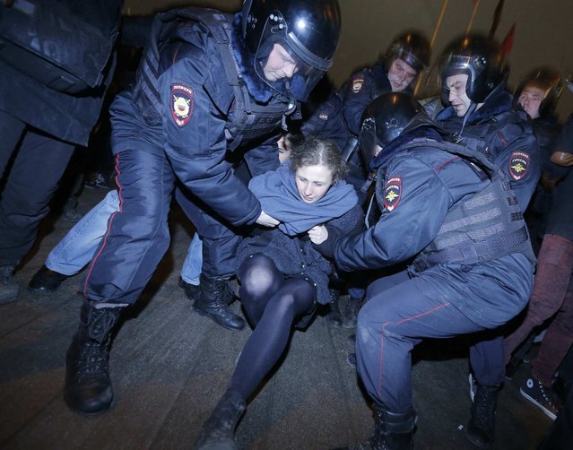 Punk protest band p*ssy Riot member Maria Alyokhina is detained by police at a protest in central Moscow February 24, 2014. Russian riot police detained over a hundred protesters, including two members of p*ssy Riot, on Monday at a Moscow courthouse where seven opponents of President Vladimir Putin were jailed from two and a half to four years over a demonstration that turned violent. (Photo by Maxim Shemetov/Reuters)