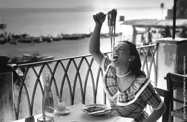 1949: 18-year old London student Mercy Haystead enjoys a plate of spaghetti, whilst on holiday in Italy as an official guest of the town of Positano