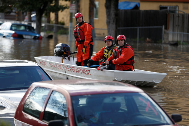 Firefighters with the San Jose Fire Department inspect vehicles partially submerged in flood water after heavy rains overflowed nearby Coyote Creek in San Jose, California, U.S., February 21, 2017. (Photo by Stephen Lam/Reuters)
