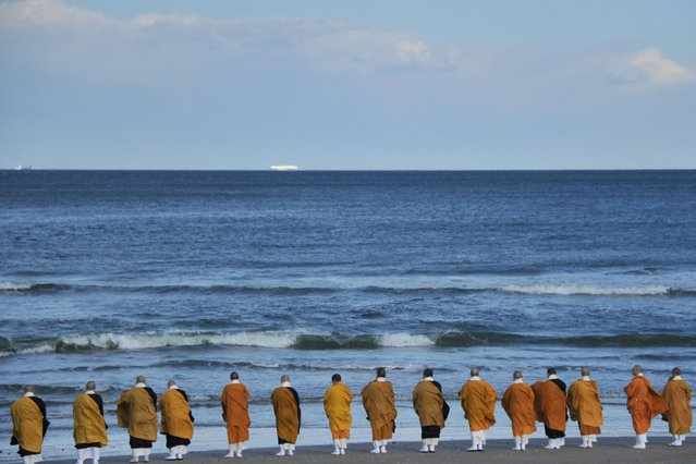 Buddhist monks read the sutras toward the Pacific Ocean to commemorate the victims of the magnitude 9.0 earthquake and subsequent tsunami at Tairausuiso beach on March 11, 2014 in Iwaki, Fukushima, Japan. Japan marks the third anniversary of the magnitude 9.0 earthquake and subsequent tsunami, which claimed more than 18,000 lives. (Photo by The Asahi Shimbun via Getty Images)