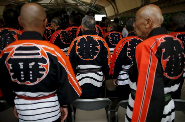 Men wearing traditional firefighters' happi coat attend a memorial service for  firefighters at Sensoji temple in Tokyo's downtown of Asakusa May 25, 2015. (Photo by Issei Kato/Reuters)