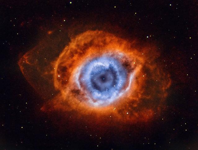 Deep in the Heart of Mordor – NGC 7293. Andrew Campbell (Australia). NGC 7293, also known as the Helix nebula, owns its name to the fact that it looks like looking down the axis of a helix. In reality, it has a surprisingly complex geometry, including radial filaments and extended outer loops. The Helix nebula is one of the brightest and closest examples of a planetary nebula, a gas cloud created at the end of the life of a sun-like star. (Photo by Andrew Campbell/National Maritime Museum)