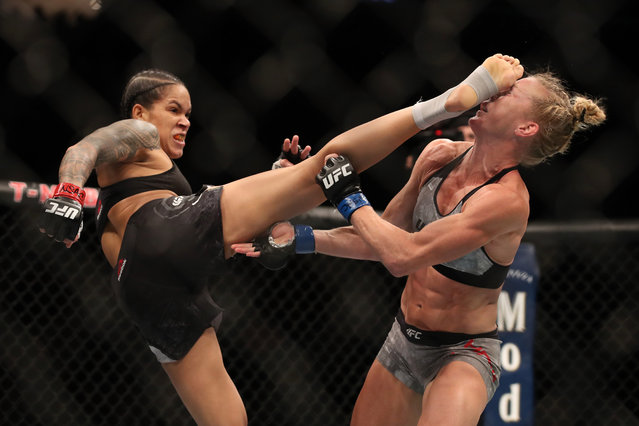 Amanda Nunes of Brazil lands a kick on Holly Holms that knocked her to the mat in the first round of their bantamweight title mixed martial arts bout during UFC 239 in Las Vegas on Saturday, July 6, 2019. Nunes won in the first round. (Photo by Steve Marcus/Las Vegas Sun via AP Photo)