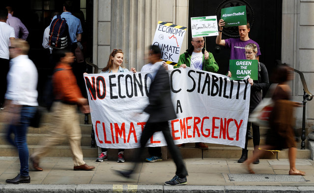 Environmental and banking system protestors demonstrate outside the Bank of England demanding that the bank rule out investment in high-carbon sectors in London, Britain July 11, 2019. (Photo by Peter Nicholls/Reuters)