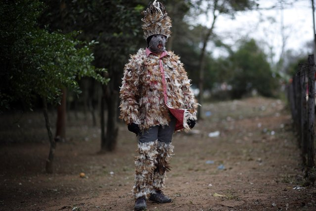 """Maria Estela Pereira, mother of 11, poses in her feathered costume, in gratitude to St. Francis Solano, in Emboscada, Paraguay, Wednesday, July 24, 2019. """"I suffer from arthritis and after praying four years ago to St. Francis Solano to allow me to move from one place to another without pain, he granted me a miracle"""", said the 52-year-old widow. (Photo by Jorge Saenz/AP Photo)"""