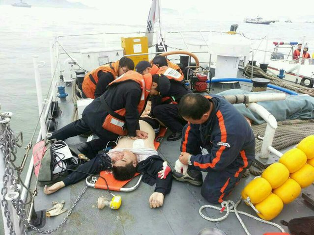 An injured passenger is given medical care after being rescued by South Korean crews. (Photo by News1/Reuters)