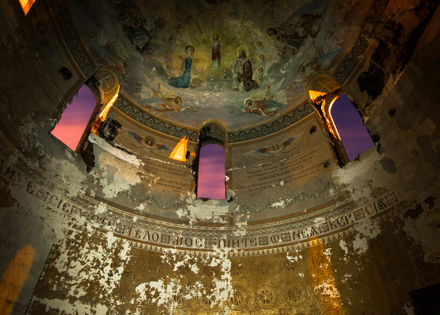 A preserved mural resides above the decaying grandeur of Cleveland's St. Joseph Byzantine church in Ohio. (Photo by Jonny Joo/Barcroft Media)