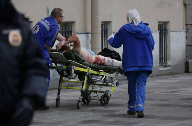 Ambulance workers push a stretcher carrying an injured person at the entrance to Tekhnologichesky Institut station of the St Petersburg metro in the aftermath of an explosion which occurred in a train at 14:40 Moscow time on April 3, 2017. According to Russian National Antiterrorism Committee several people were killed in the explosion. (Photo by Anton Vaganov/TASS)