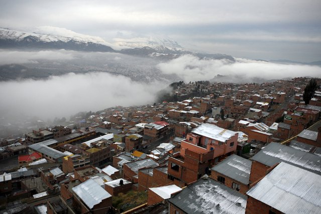 The capital city of La Paz is seen after a snow storm, in this general view taken from El Alto, Bolivia July 4, 2015. When Pope Francis visits Bolivia next week, he will discover a nation that cherishes animal sacrifices and pagan worship and where relations between indigenous communities and the Roman Catholic Church have been strained. The country's first indigenous president, Evo Morales, has frequently clashed with the church. (Photo by Maite Mercado/Reuters)