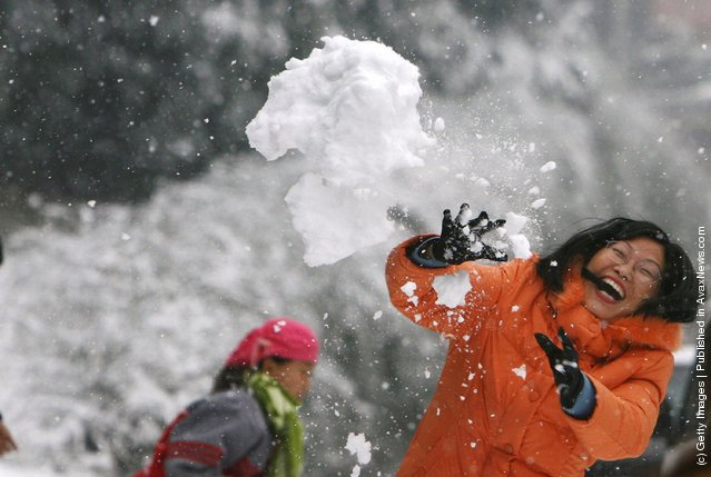 Residents have a snowball fight at a field in Nanjing of Jiangsu Province, China