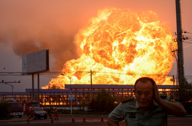 An explosion at a petrochemical plant is seen in Rizhao, Shandong province, July 16, 2015. According to Xinhua News Agency, a fire broke out after the explosion, which was caused by a liquified hydrocarbon leak at the plant, on Thursday morning. There was no report of casualties yet. (Photo by Reuters/China Daily)