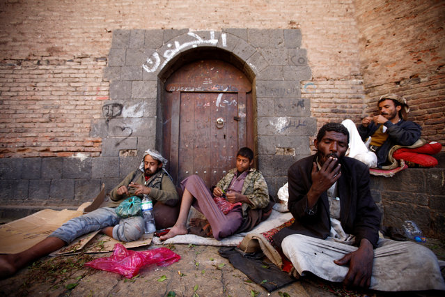 Men rest as they smoke and chew Qat, a stimulant, in the old market in the historic city of Sanaa, Yemen, January 8, 2017. (Photo by Mohamed al-Sayaghi/Reuters)