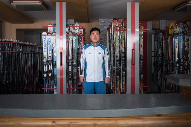 In this photo taken on February 20, 2017, Kim Chol-Nam, 30, poses for a portrait at the ski hire desk where he works at the Masikryong, or Masik Pass, ski resort near Wonsan. (Photo by Ed Jones/AFP Photo)